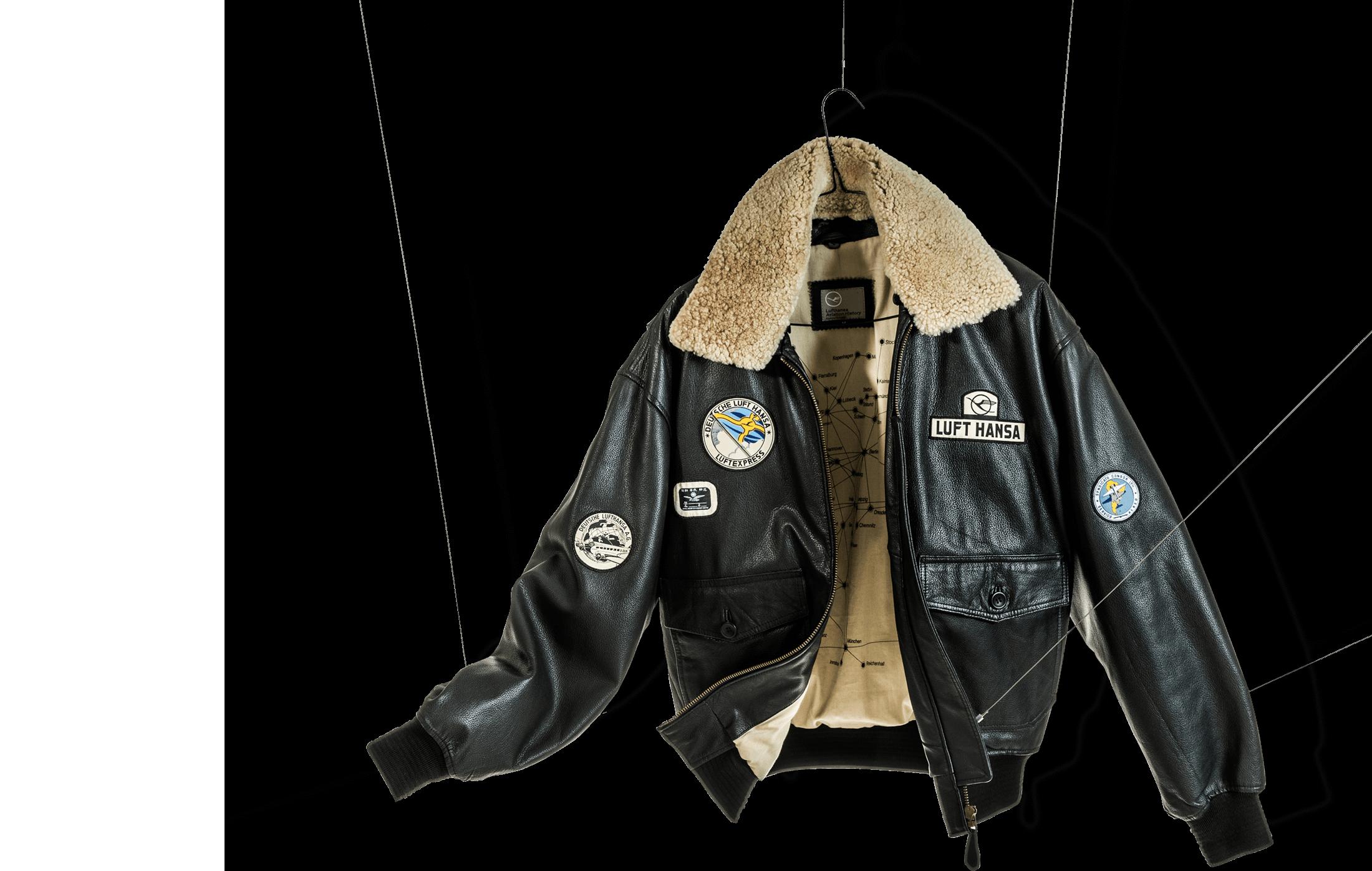 Lufthansa Lederjacke mit Badges aufgehängt an Stahlfäden als Beispiel für Corporate Fashion