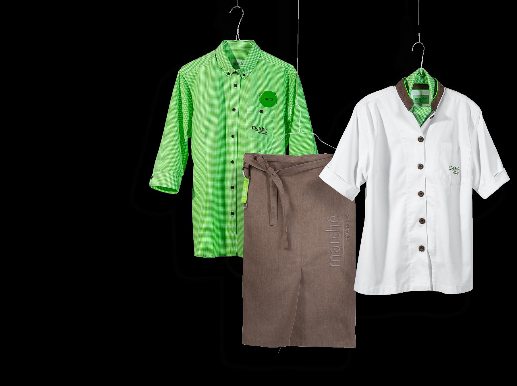 Mitarbeiterbekleidung für Marche. Hemd, Kochjacke und braue Schürze an Kleiderhaken aufgehängt